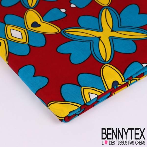Wax Africain N°116 : Motif Caléïdoscope bleu, jaune, blanc sur fond rouge cerise
