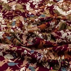 Microfibre Imprimé Fleurs et Feuille en Solarisation Multicolore fond Bordeaux