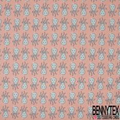Coton imprimé Motif pieuvres bleues sur fond corail pâle