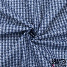 Coton imprimé motif petites gouttes fantaisistes sur fond bleu