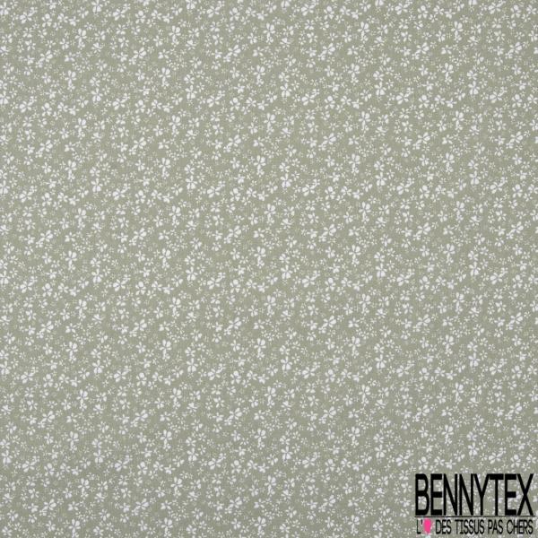 Coton imprimé motif petites fleurs blanches sur fond tilleul