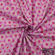 Coton imprimé motif mandalas multicolores sur fond fushia