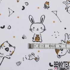 Coton imprimé motif animaux enfantins noirs et moutardes sur fond blanc
