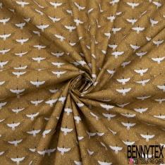 Coton imprimé motif héron japonisant blanc sur fond ocre