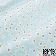 Coton imprimé motif plantes blanches et ocres sur fond bleu ciel