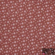 Coton imprimé motif flocons blancs sur fond rouge tomette