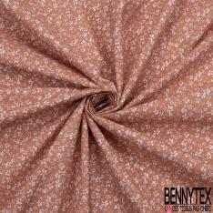Coton imprimé motif petites fleurs blanches sur fond saumon