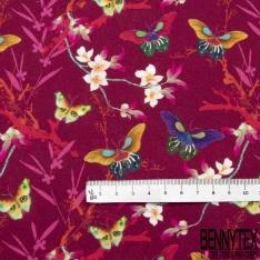 Coton imprimé digital motif papillon et fleur multicolore Fond fuchsia