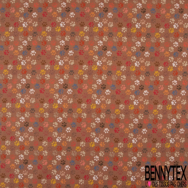 Coton imprimé digital motif patte de chien multicolore Fond terracotta