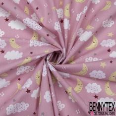 Coton imprimé motif lune jaune étoile multicolore et nuage Fond rose dragée