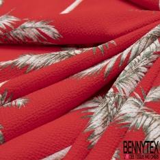 Crêpe Polyester Imprimé Motif palmier blanc et vert Fond rouge vif