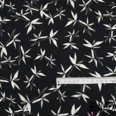Coton imprimé Motif feuille blanche et kaki Fond noir délavé