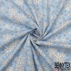 Coton imprimé Motif Floral blanc Fond bleu ciel