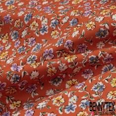 Coton imprimé Motif fleur multicolore Fond orange carotte