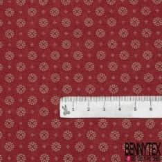 Coton imprimé Motif flocon de neige taupe Fond bordeaux