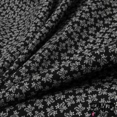 Coton imprimé Motif feuille blanche Fond noir