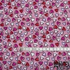 Coton imprimé Motif coeur rouge mauve fuchsia et blanc Fond rose
